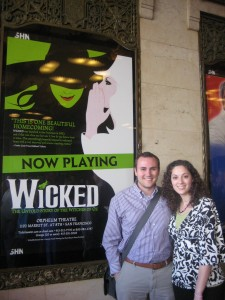 Brett & Sarah in front of the Wicked poster